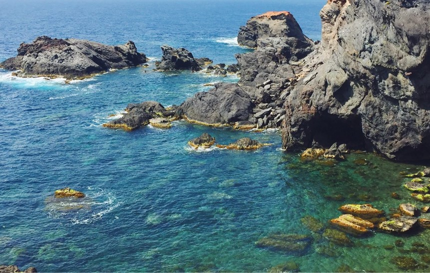 Take a swim in the blue green ocean in the Marin reserve, Cabo de Palos, spain
