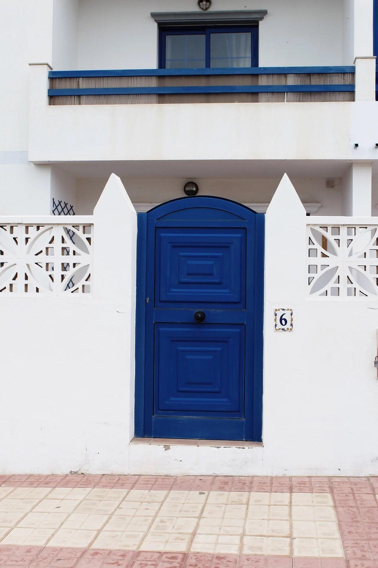 White Wall, blue door