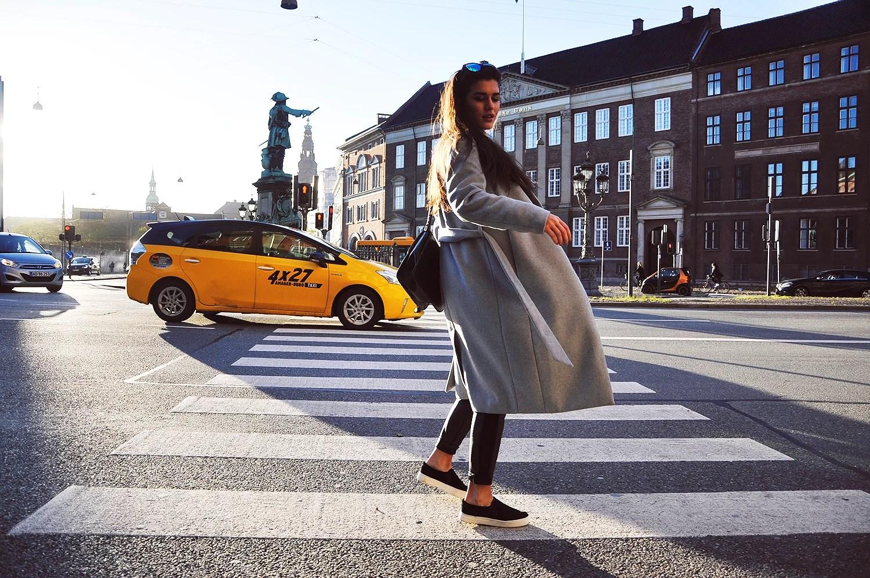 grey coat yellow car